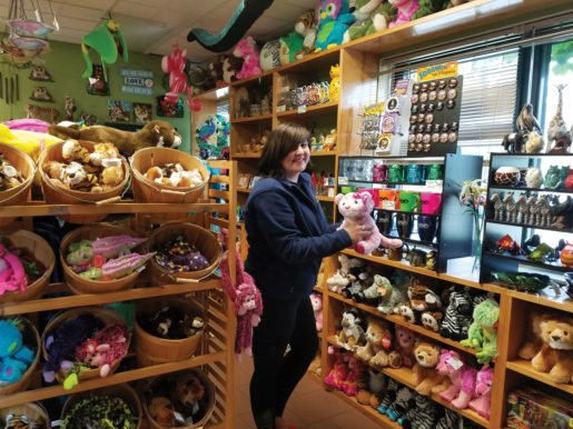 Briana Stantz, a gift shop cashier at the Washington Park Zoo in Michigan City. The store's retail manager likes to hang apparel so any images are visible, or to make sure pictures of the design are shown with the display.