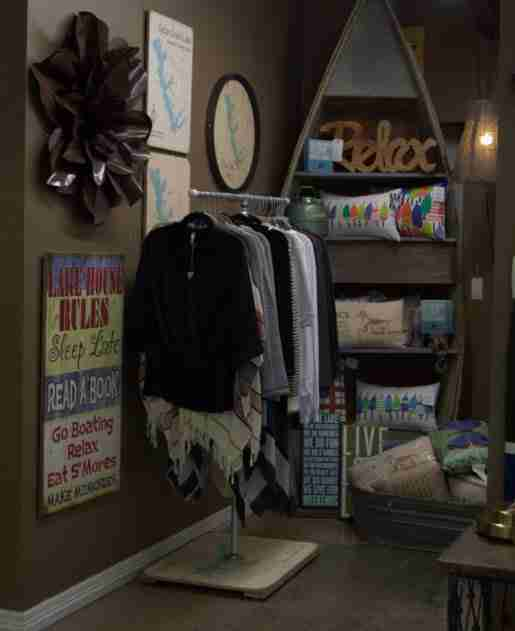 Apparel and signs share display space at Lakehouse Outfitters. After initial success with graphic tees, the store has added to its apparel selection.
