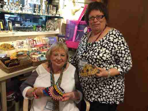 Corrinne Dropkin, left, and Arleen Peltz, of the Jewish Home and Care Center in Milwaukee, Wis. The gift store is run entirely by volunteers, and Peltz does the books and most of the buying, although all of the volunteers get to choose items to order. Peltz and Dropkin are shown holding hand-made yarmulkes that were purchased from Ethiopia and Israel.