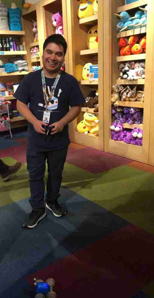 Robert Ontiveros, guest service representative, Chicago Children's Museum. The store makes use of feature tables to highlight new items.