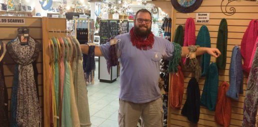 Matt Palmer photographed with scarves at Sunset Beach Gifts. The owner said placing scarves, glasses and other fashion accessories near clothing helps spur sales.