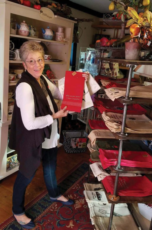 Kathy photographed with linens at Grapevine Farms in Cobleskill, N.Y. The co-owner said that stocking unique products helps sell more gifts.